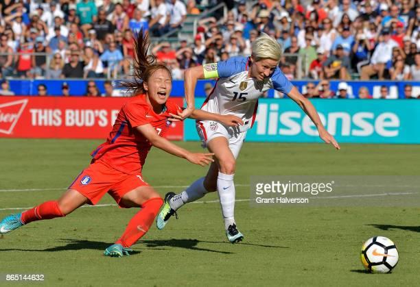 Jang Selgi of Korea Republic defends a run by Megan Rapinoe of USA during their game at WakeMed Soccer Park on October 22 2017 in Cary North Carolina...