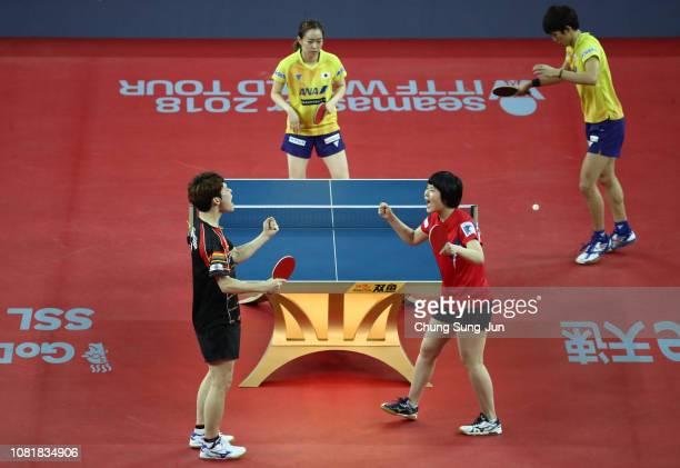 Jang Woo-jin of South Korea and Cha Hyo-Sim of North Korea celebrate after winning against Kasumi Ishikawa and Maharu Yoshimura of Japan compete in...