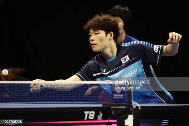 Jang Woo-Jin of South Korea and Cha Hyo-Sim of North Korea compete against Ho Kwan Kit and Lee Ho-Ching of Hong Kong in the Mixed Double -...