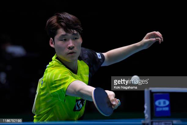 Jang Woojin of South Korea competes against Fan Zhendong of China during match 1 of the men's team singles final on day five of the ITTF Team World...