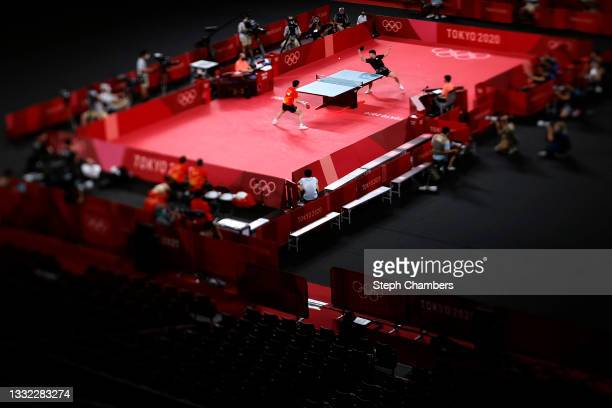 Jang Woo-jin of Team South Korea returns the ball during his Men's Team Semi-finals table tennis match against Fan Zhendong of Team China on day...