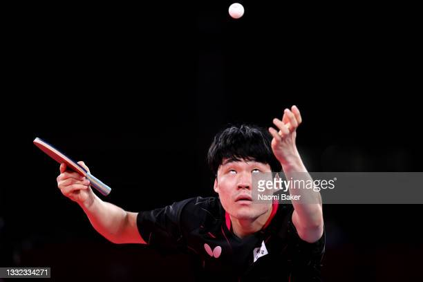 Jang Woo-jin of Team South Korea serves as he competes against China's Fan Zhendong during their men's team semifinal table tennis match on day...