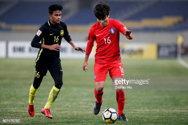 Jang Yunho of South Korea and Muhammad Danial Amier Bin Norhisham of Malaysia in action during AFC U23 Championship Quarterfinal between South Korea...