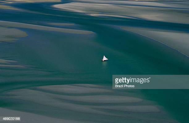 Jangada sails through sand banks seaworth sailing raft used by fishermen of northeastern Brazil Ceará State shore near Fortaleza