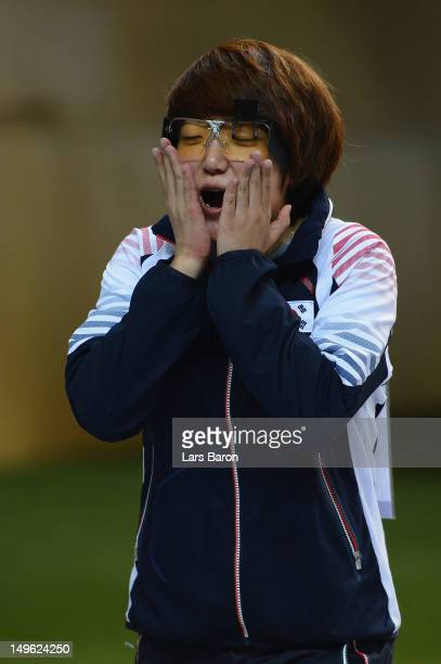 Jangmi Kim of Korea celebrates winning gold medal in the Women's 25m Pistol Shooting final on Day 5 of the London 2012 Olympic Games at The Royal...