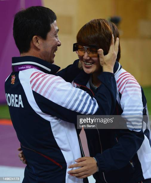 Jangmi Kim of Korea celebrates winning gold medal with her coach Jangsoo Lim in the Women's 25m Pistol Shooting final on Day 5 of the London 2012...