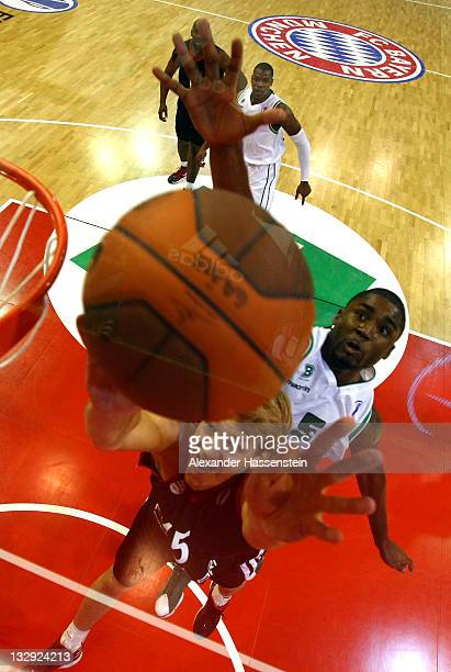 JanHendrik Jagal of Muenchen battles for the ball with E´twaun Moore of Treviso during the Eurocup Basketball match between FC Bayern Muenchen and...