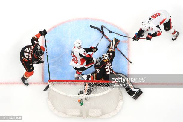 Jani Hakanpaa and Ryan Miller of the Anaheim Ducks defend against Anthony Duclair and Bobby Ryan of the Ottawa Senators during the second period of a...