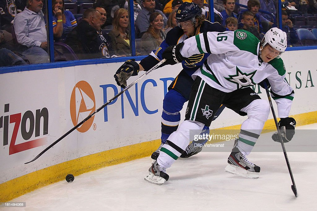 Jani Hakanpaa #51 of the St. Louis Blues and Ryan Garbutt #16 of the Dallas Stars fight for control of the puck during a preseason at the Scottrade Center on September 21, 2013 in St. Louis, Missouri.