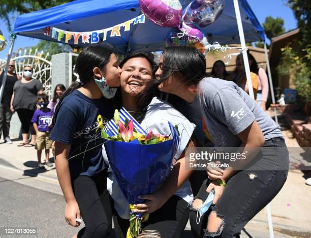 Janiah Juarez Delilah Juarez and Miah Juarez celebrate Delilah Juarez's birthday during a birthday parade hosted by Tyler Robinson Foundation in...