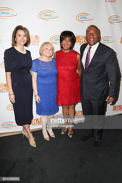 Janice Arouh Joan Robbins Caroline Folks and Byron Allen arrive at the 14th Annual Lupus LA Hollywood Bag Ladies Luncheon at The Beverly Hilton Hotel...