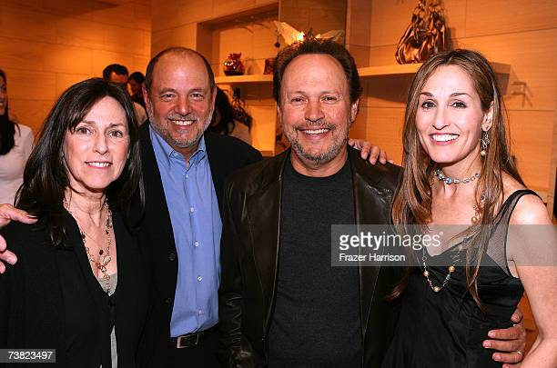 Janice Crystal Larry Brezner producer Billy Crystalactor Dominique Cohen pose at the opening of Dominique Cohen Flagship Jewelry Store on Robertson...