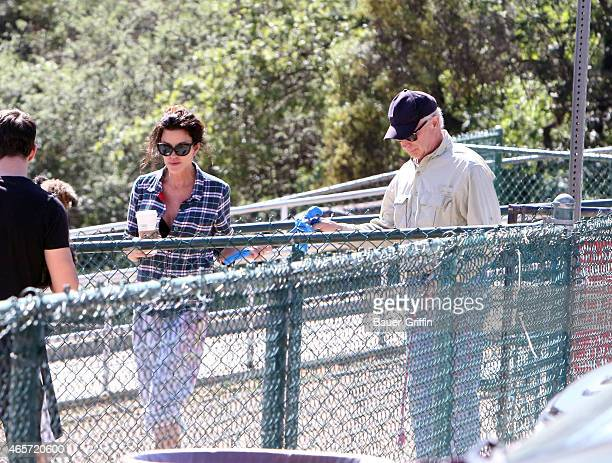 Janice Dickinson is seen with her Chocolate Labrador and Bulldog named Lloyd on March 09 2015 in Los Angeles California