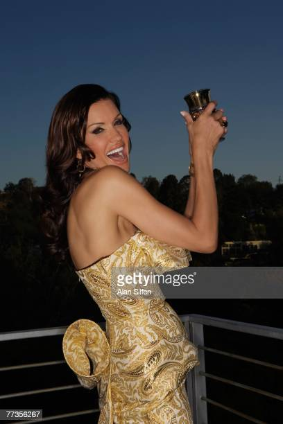 Janice Dickinson poses for a photo during a portrait shoot at her home on April 27 2007 in the Hollywood Hills California Artists from...