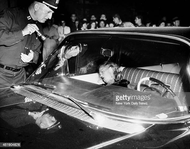 Janice Drake lies dead in a car with mobster Little Augie Pisano at 94th St and 24th Ave in Queens