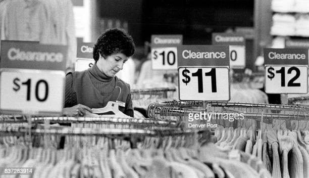 311989 Janice Gonzaes a Glendale Target employee straightens sale racks with post Christmas merchandise Credit The Denver Post
