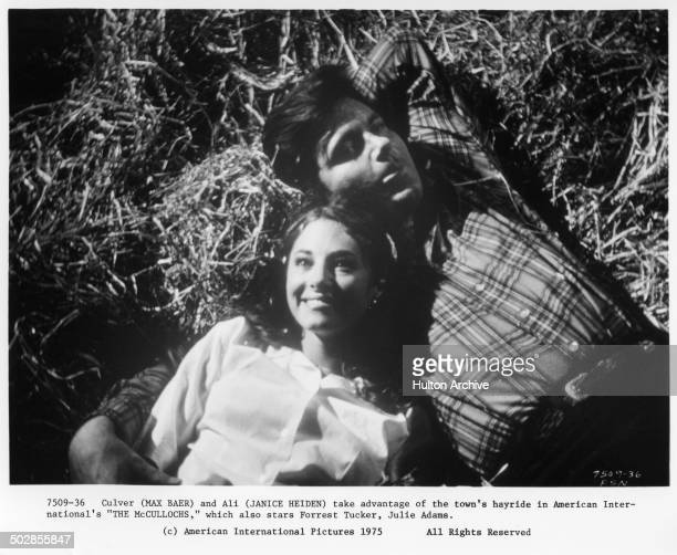 Janice Heiden and Max Baer Jr lay in hay in a scene for the movie The Wild McCullochs circa 1975