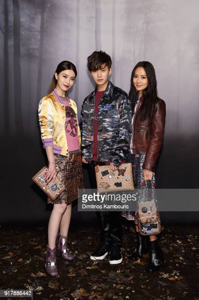 Janice Man Allen Ren JiaLun and Aimee Yun Yun Sun attend the Coach Fall 2018 Runway Show at Basketball City on February 13 2018 in New York City