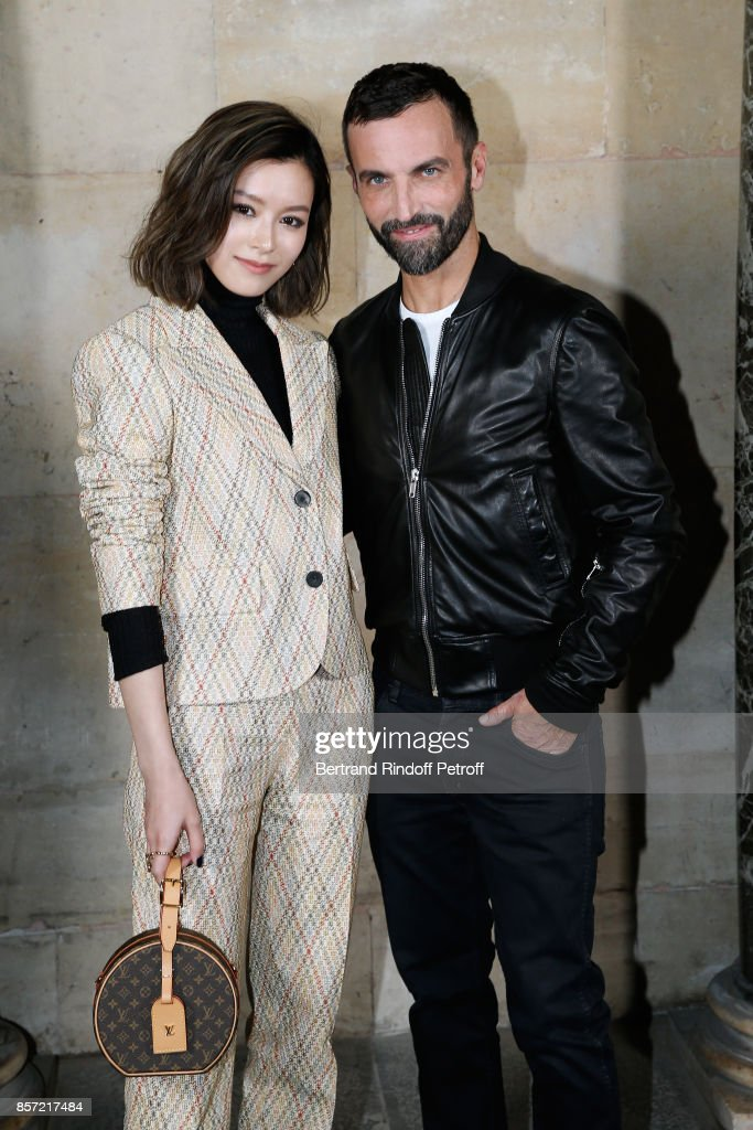 Janice Man and stylist Nicolas Ghesquiere pose after the Louis Vuitton show as part of the Paris Fashion Week Womenswear Spring/Summer 2018 on October 3, 2017 in Paris, France.