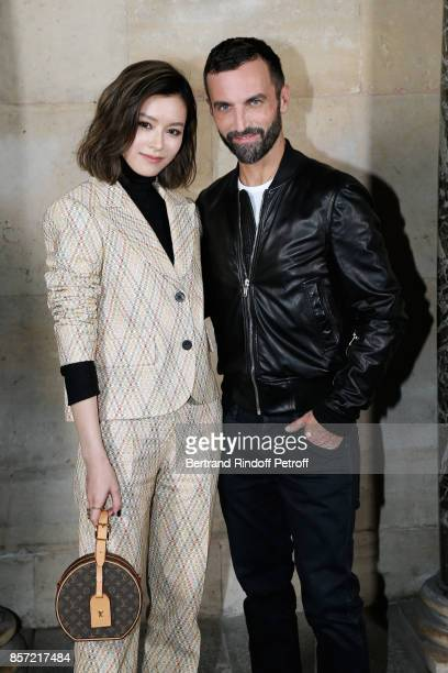Janice Man and stylist Nicolas Ghesquiere pose after the Louis Vuitton show as part of the Paris Fashion Week Womenswear Spring/Summer 2018 on...