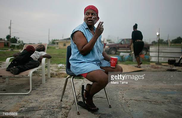 Janice Miller smokes outside the old motor home she is currently living in with three other people in the Lower Ninth Ward June 10 2007 in New...