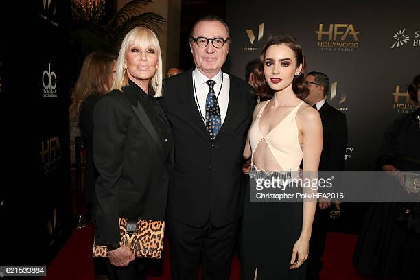 Janice Pennington De Abreu Hollywood Film Festival founder Carlos de Abreu and actress Lily Collins attend the 20th Annual Hollywood Film Awards on...