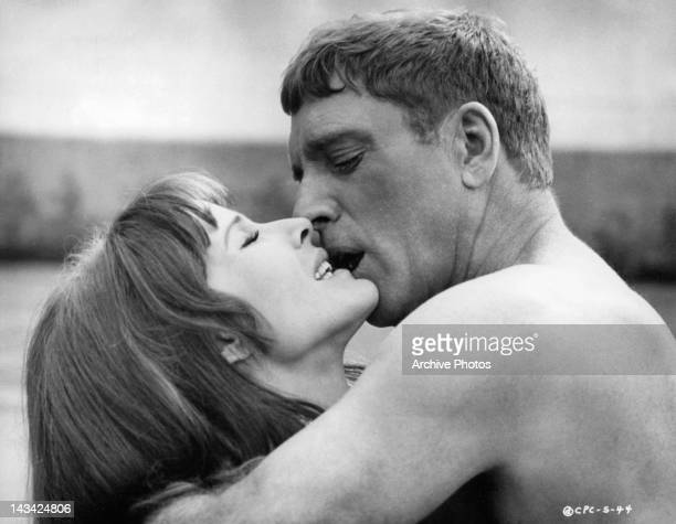 Janice Rule and Burt Lancaster kiss in a scene from the film 'The Swimmer' 1968