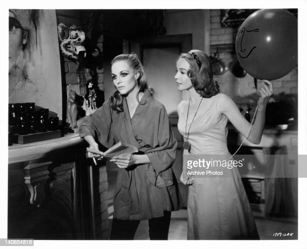 Janice Rule and Leslie Caron talk in a scene from the film 'The Subterraneans' 1960