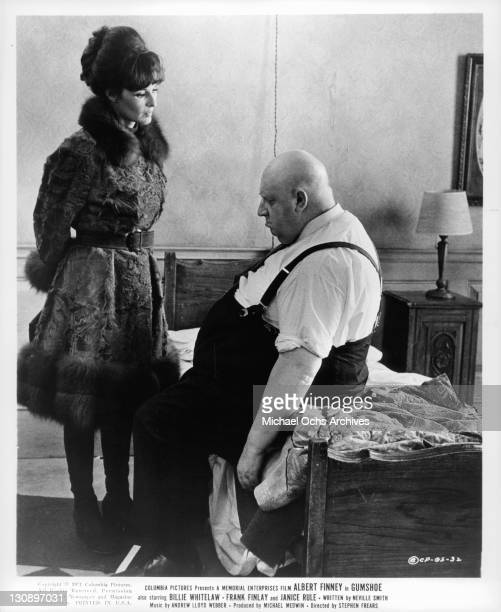Janice Rule stands and speaks to George Silver while he sits at the edge of the bed in a scene from the film 'Gumshoe' 1971