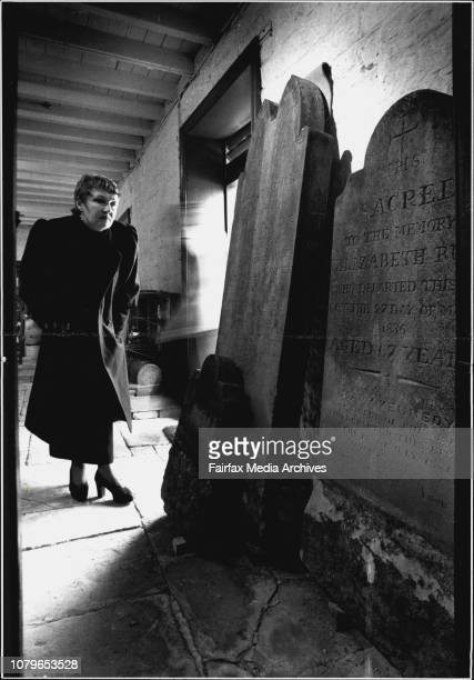 Janice Ruse Israel and the headstones of her ancestors James Ruse and wife Elizabeth which she had removed from St Johns Cemetery at Campbelltown...