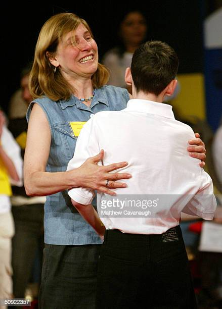 Janice Tidmarsh of South Bend Indiana congratulates her son David after he won the National Spelling Bee June 3 2004 in Washington DC Tidmarsh...