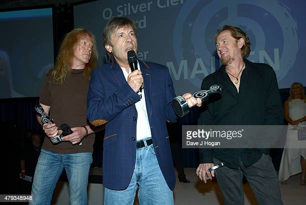 Janick Gers Bruce Dickerson and Adrian Smith from Iron Maiden with their O2 Silver Clef award at the Nordoff Robbins O2 Silver Clef awards at the...