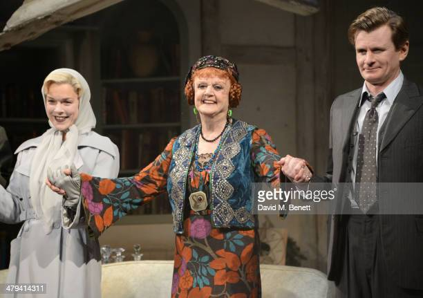 Janie Dee Dame Angela Lansbury and Charles Edwards bow at the curtain call during the press night performance of Blithe Spirit at the Gielgud Theatre...