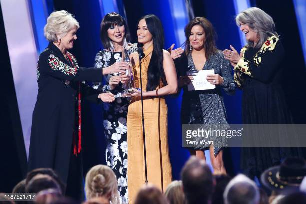 Janie Fricke Pam Tillis Kacey Musgraves Martina McBride and Kathy Mattea speak onstage during the 53rd annual CMA Awards at the Bridgestone Arena on...