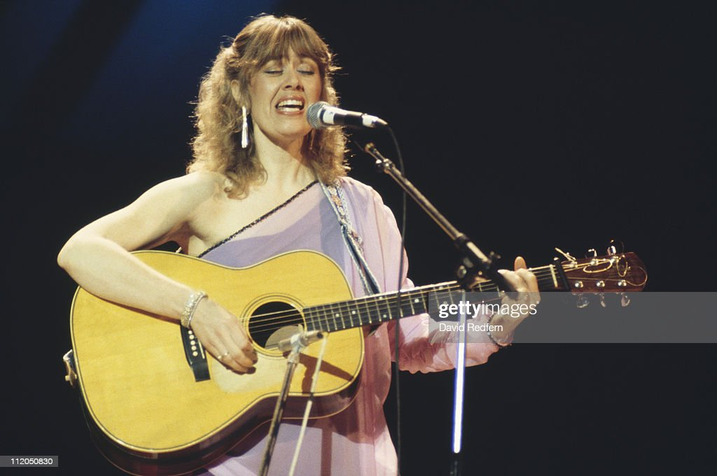 Janie Fricke, U.S. country music singer, playing the guitar and singing during a concert, circa 1970.