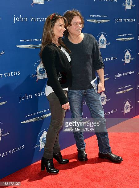 Janie Liszewski and guitarist Eddie Van Halen attend the John Varvatos 10th Annual Stuart House Benefit presented by Chrysler Kids Tent by Hasbro...