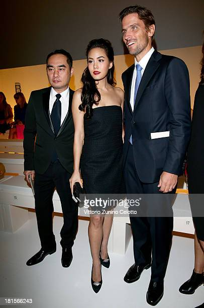 Janie Tienphosuwan and James Ferragamo attend the Salvatore Ferragamo show as part of Milan Fashion Week Womenswear Spring/Summer 2014 at on...