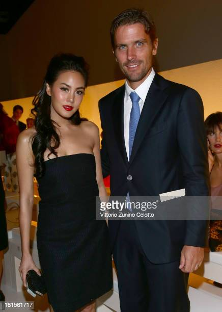 Janie Tienphosuwan and James Ferragamo attends the Salvatore Ferragamo show as part of Milan Fashion Week Womenswear Spring/Summer 2014 at on...
