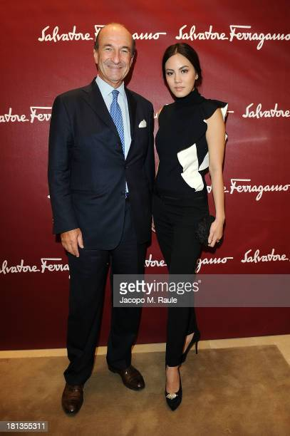 Janie Tienphosuwan and Michele Norsa attend the Salvatore Ferragamo Boutique Opening as part of Milan Fashion Week Womenswear Spring/Summer 2014 on...