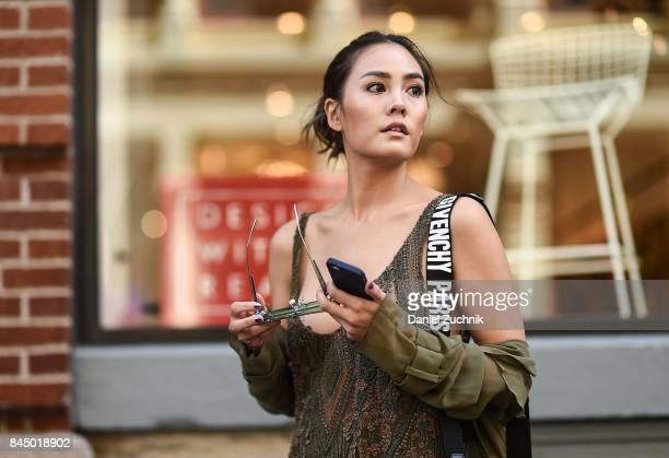 Janie Tienphosuwan is seen wearing a Sally Lapointe dress Givenchy bag and Gentlemonster sunglasses outside the Rebecca Minkoff show during New York...