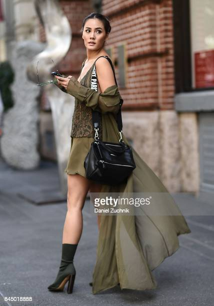 Janie Tienphosuwan is seen wearing a Sally Lapointe dress Yeezy shoes Givenchy bag and Gentlemonster sunglasses outside the Rebecca Minkoff show...