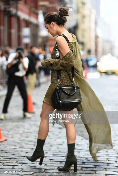 Janie Tienphosuwan is seen wearing a Sally Lapointe dress Yeezy shoes and a Givenchy bag outside the Rebecca Minkoff show during New York Fashion...