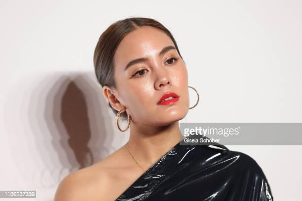 Janie Tienphosuwan wearing jewelry by Clash de Cartier during the Clash de Cartier event at la Conciergerie on April 10 2019 in Paris France