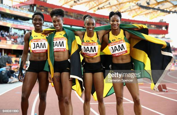 Janieve Russell Christine Day Stephenie McPherson and Anastasia LeRoy of Jamaica celebrate winning gold after the Women's 4x400 metres relay final...