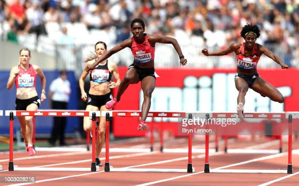 Janieve Russell of Jamaica and Shamier Little of USA compete in the Women's 400m Hurdles Race during Day One of the Muller Anniversary Games at...