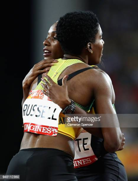 Janieve Russell of Jamaica celebrates winning gold with Ronda Whyte of Jamaica after the Women's 400 metres hurdles final during athletics on day...