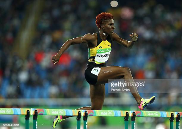 Janieve Russell of Jamaica competes during the Women's 400m Hurdles Round 1 Heat 2 on Day 10 of the Rio 2016 Olympic Games at the Olympic Stadium on...