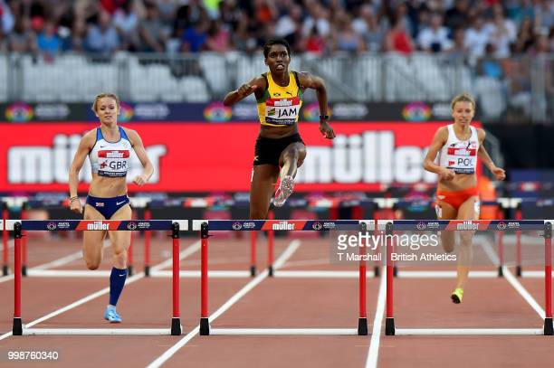 Janieve Russell of Jamaica leads Meghan Beesley of Great Britain and Joanna Linkiewicz of Poland during the Women's 400m Hurdles during day one of...