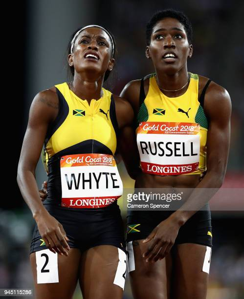 Janieve Russell of Jamaica looks on after winning gold with Ronda Whyte of Jamaica after the Women's 400 metres hurdles final during athletics on day...