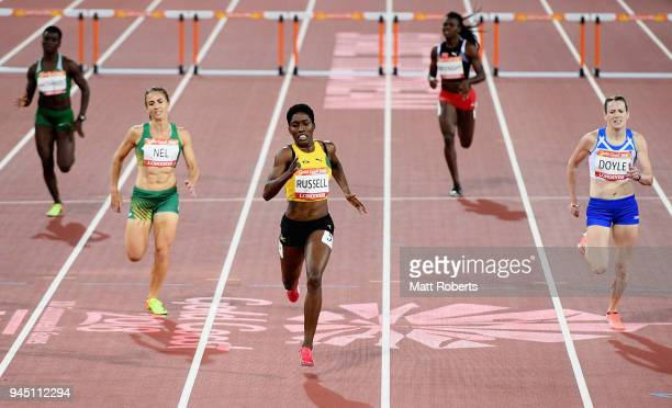 Janieve Russell of Jamaica races to the line to win gold ahead of Wenda Nel of South Africa and Eilidh Doyle of Scotland in the Women's 400 metres...